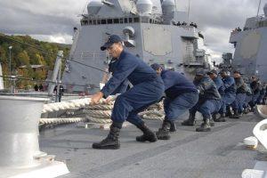 Men pulling rope
